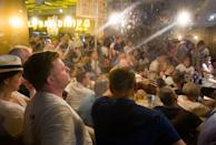 Tottenham supporters watch the UEFA Champions League final in a restaurant in Madrid on June 1, 2019. (Photo by Loli San Jose / AFP)