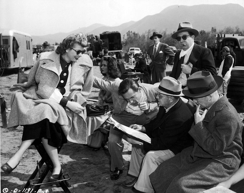 <p>Lucille sits between takes on the set of <em>Miss Grant Takes Richmond </em>and discusses the scene with director, Lloyd Bacon and her costars.</p>