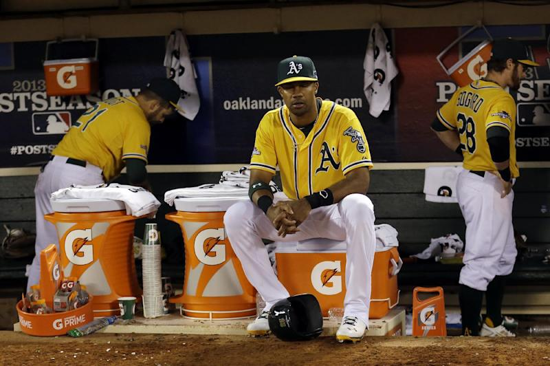 Oakland Athletics center fielder Chris Young sits on a gatorade cooler after the Oakland Athletics lost 3-0 to the Detroit Tigers in Game 5 of an American League baseball division series in Oakland, Calif., Thursday, Oct. 10, 2013. (AP Photo/Marcio Jose Sanchez)