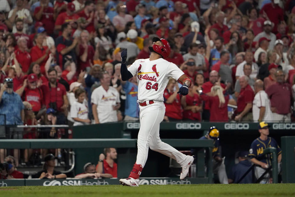 St. Louis Cardinals' Jose Rondon looks skyward as he rounds the bases after hitting a solo home run during the sixth inning of a baseball game against the Milwaukee Brewers Tuesday, Sept. 28, 2021, in St. Louis. (AP Photo/Jeff Roberson)