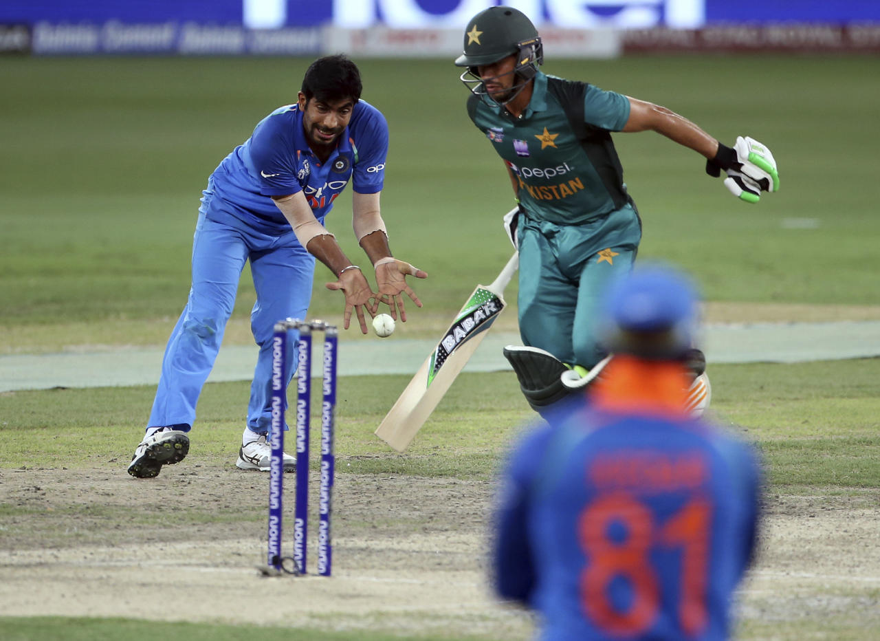 India's Jasprit Bumrah, left, attempts to run-out Pakistan's Mohammad Nawaz, right in green, during the one day international cricket match of Asia Cup between India and Pakistan in Dubai, United Arab Emirates, Sunday, Sept. 23, 2018. (AP Photo/Aijaz Rahi)