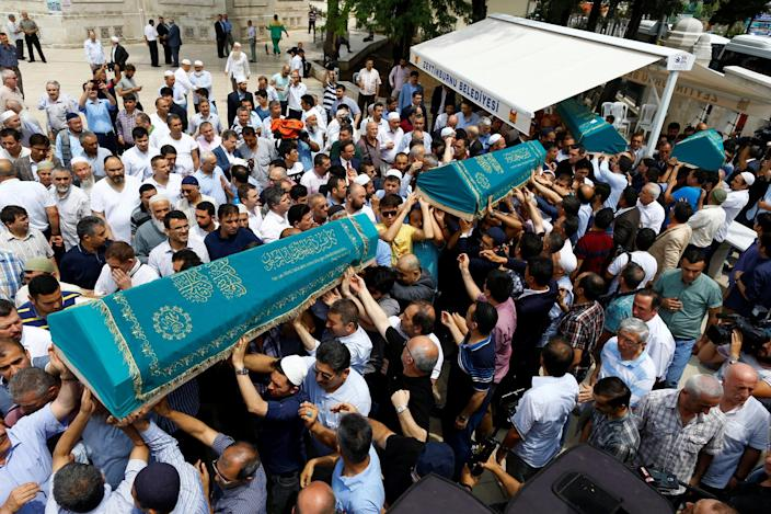 <p>Relatives of four victims, who were members of the Amiri family who were killed in Tuesday's attack at the Istanbul airport, carry their coffins during their funeral ceremony in Istanbul, Turkey, June 30, 2016. (REUTERS/Osman Orsal) </p>