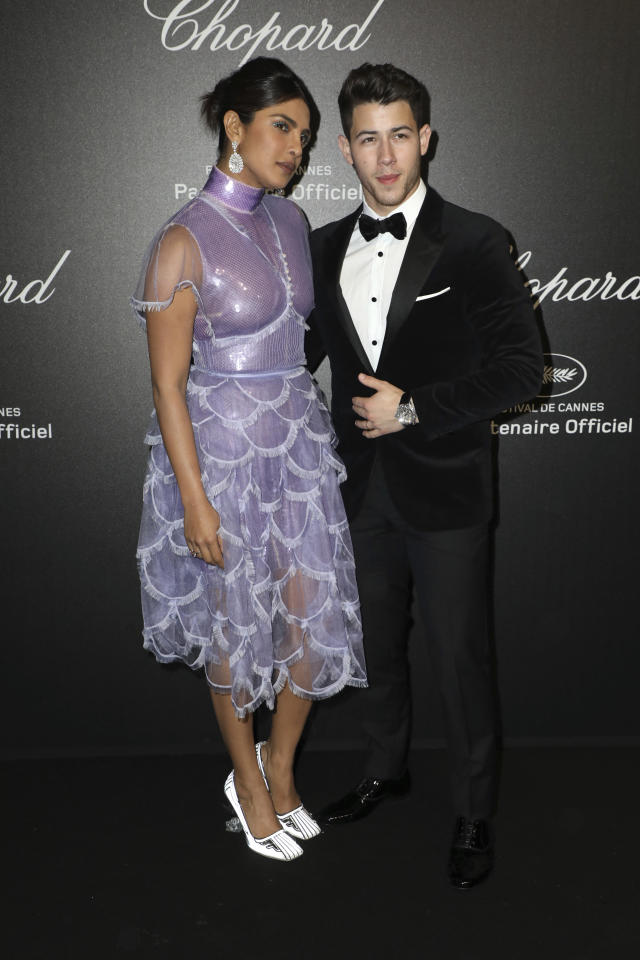Actress Priyanka Chopra, left, and singer Nick Jonas pose for photographers upon arrival at the Chopard Love event at the 72nd international film festival, Cannes, southern France, Friday, May 17, 2019. (Photo by Vianney Le Caer/Invision/AP)