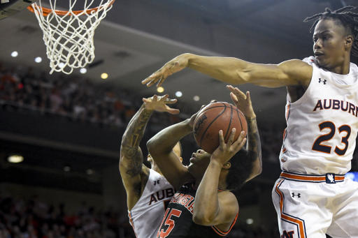 Auburn guard J'Von McCormick (5) and forward Isaac Okoro (23) block a shot by Georgia guard Sahvir Wheeler (15) during the first half of an NCAA college basketball game Saturday, Jan. 11, 2020, in Auburn, Ala. (AP Photo/Julie Bennett)