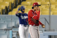 Los Angeles Angels starter Shohei Ohtani walks off the mound after giving up a solo home run to Los Angeles Dodgers' Corey Seager during the second inning of a spring training exhibition baseball game Monday, March 29, 2021, in Los Angeles. (AP Photo/Marcio Jose Sanchez)