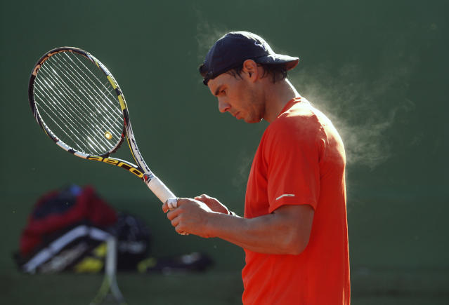 Spain's Rafael Nadal practices during a training session at Manacor tennis club on the Spanish Balearic island of Mallorca, January 30, 2013. Nadal is keeping his expectations low ahead of his long-awaited return to competitive action in early February after seven months out of tennis with a knee injury. The 26-year-old French Open champion has not played since losing to Czech Lukas Rosol in the second round at Wimbledon in June due to a partial tear of the patella tendon and inflammation in his left knee. REUTERS/Enrique Calvo (SPAIN - Tags: SPORT TENNIS TPX IMAGES OF THE DAY) - RTR3D5N9