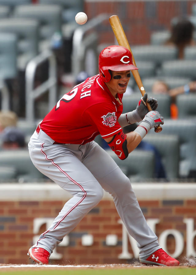 Cincinnati Reds Derek Dietrich (22) is hit by a pitch in the fourth inning of a baseball game against the Atlanta Braves, Sunday, Aug. 4, 2019, in Atlanta. (AP Photo/Todd Kirkland)