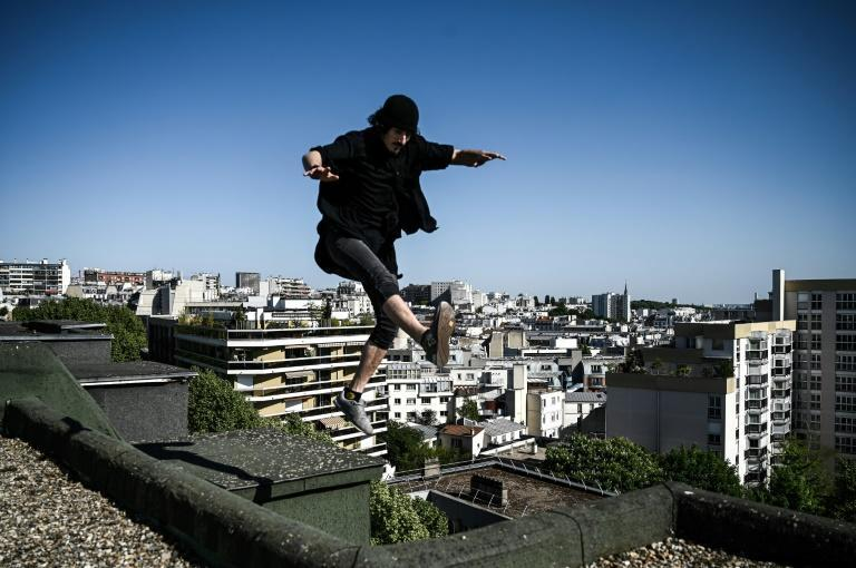 Between pavement and stars: freerunner Simon Nogueira flits across the roof tops of Paris