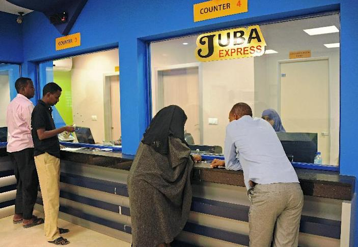 Customers wait for foreign money transfers in Mogadishu on February 12, 2015 in Somalia where no formal banking system exists (AFP Photo/Mohamed Abdiwahab)