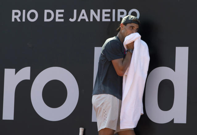 Spain's Rafael Nadal leans against the wall during his training session for the Rio Open in Rio de Janeiro, Brazil, Friday, Feb. 14, 2014. Top-ranked Nadal injured his back warming up for the final of the Australian Open almost three weeks ago, eventually losing against Stanislas Wawrinka, a match he was an overwhelming favorite to win. Nadal has practiced little since then, getting treatment at home in Mallorca. His first test comes in next week's Rio Open, a new stop on the ATP Tour. (AP Photo/Silvia Izquierdo)