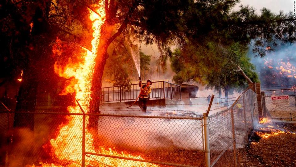 """<p>Cal Fire Capt. Jesse Campbell works to save the Louis Stralla Water Treatment Plant as the Glass Fire burns in St. Helena.</p><div class=""""cnn--image__credit""""><em><small>Credit: Noah Berger/AP / AP licensed</small></em></div>"""