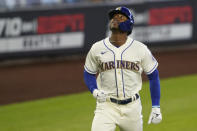 Seattle Mariners' Kyle Lewis looks up as he rounds the bases after hitting a solo home run against the Texas Rangers during the first inning of a baseball game, Sunday, Aug. 23, 2020, in Seattle. (AP Photo/Ted S. Warren)
