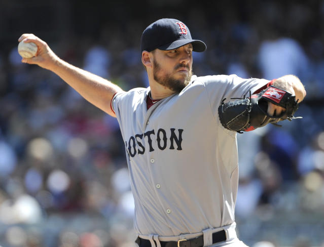 Boston Red Sox pitcher John Lackey delivers the ball to the New York Yankees during the first inning of a baseball game Saturday, Sept. 7, 2013, at Yankee Stadium in New York. (AP Photo/Bill Kostroun)