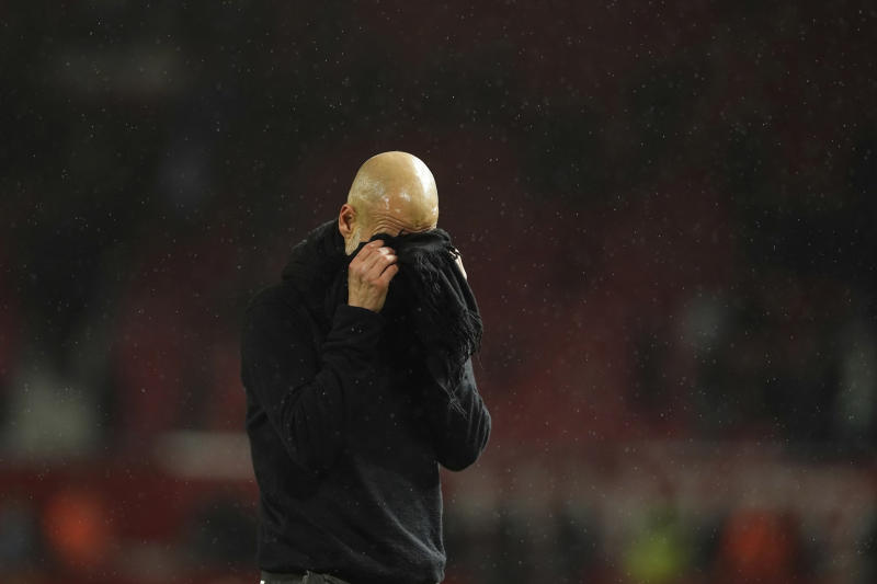 Manchester City's head coach Pep Guardiola reacts after the English Premier League soccer match between Manchester United and Manchester City at Old Trafford in Manchester, England, Sunday, March 8, 2020. (AP Photo/Dave Thompson)