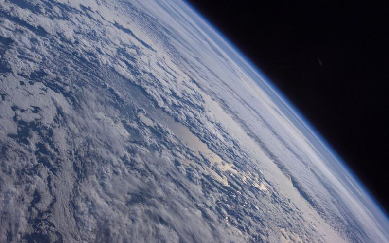 Earths horizon against the blackness of space is featured in this image photographed by an Expedition 7 crewmember onboard the International Space Station (ISS) on October 4, 2003
