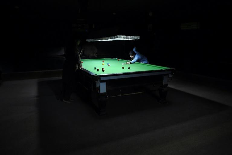 Every evening, young men head to the Arena club, a trendy cafe in Kandahar, to play snooker, watch football on a big screen, or smoke shisha
