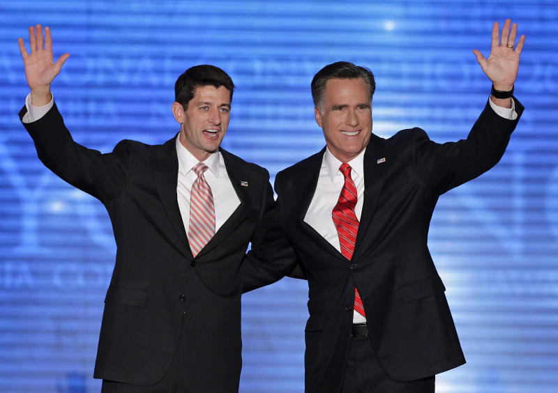 Republican presidential nominee Mitt Romney and vice presidential nominee, Rep. Paul Ryan, left, wave to delegates during the Republican National Convention in Tampa, Fla., on Thursday, Aug. 30, 2012. (AP Photo/J. Scott Applewhite)