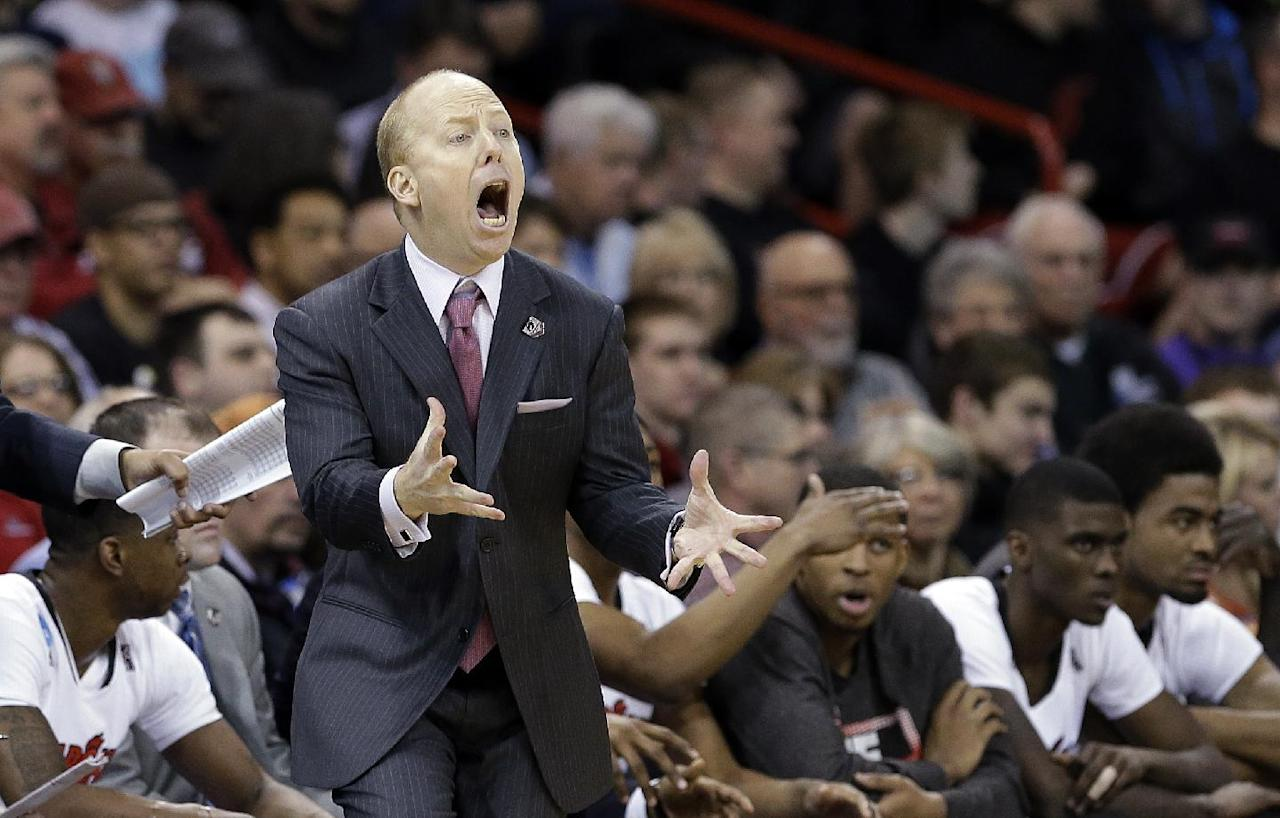 Cincinnati head coach Mick Cronin reacts to a call in favor of Harvard during the second half in the second round of the NCAA college basketball tournament in Spokane, Wash., Thursday, March 20, 2014. Harvard won 61-57. (AP Photo/Elaine Thompson)