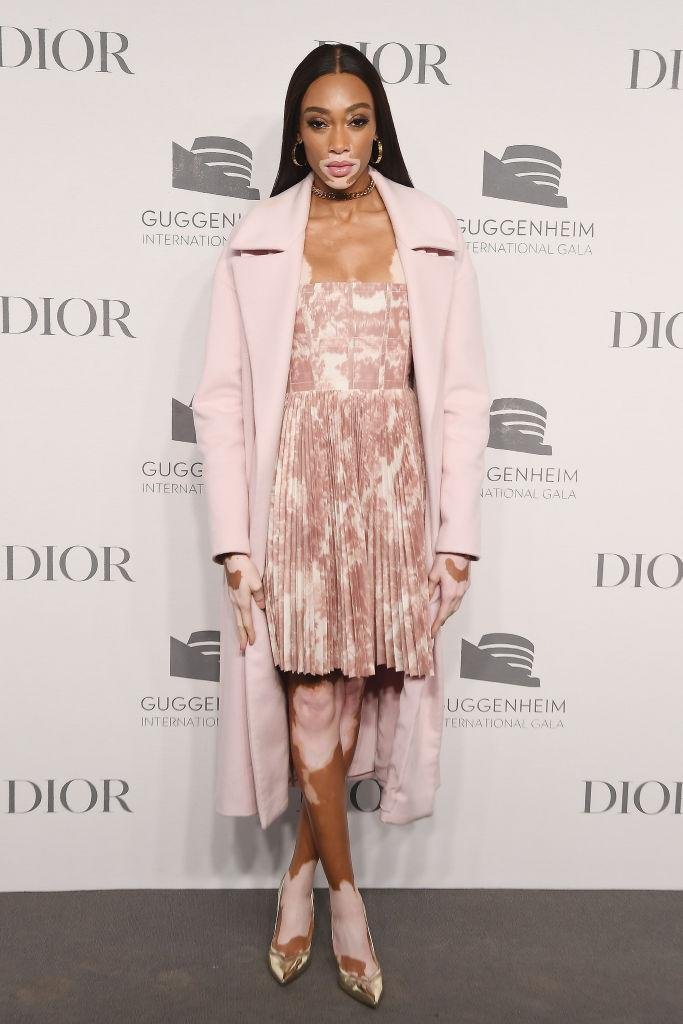 <p>Model Winnie Harlow attended the 2018 Guggenheim International Gala Pre-Party by Dior on November 18. For the evening event, the 24-year-old wore a pink toile mini dress with a winter-ready coat. <em>[Photo: Getty]</em> </p>