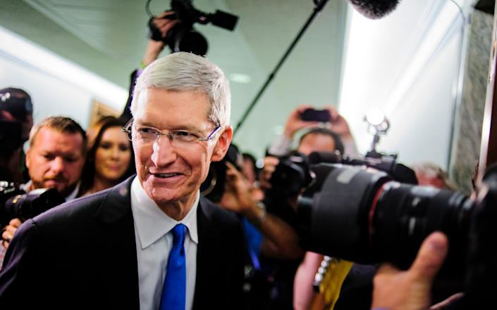 Tim Cook at a hearing about taxes in 2013 - Bloomberg