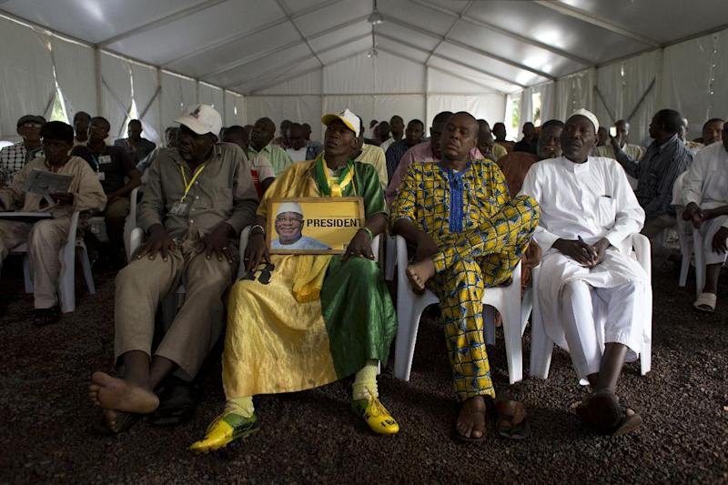 Supporters of Ibrahim Boubacar Keita watch the televised reading of election results, at Keita campaign headquarters in Bamako, Mali, Friday, Aug. 2, 2013. Mali's presidential race will go to a second round on Aug. 11. Keita finished with a strong lead over his next closest rival, Soumaila Cisse, but still well shy of the majority needed to win outright in the first round.(AP Photo / Rebecca Blackwell)