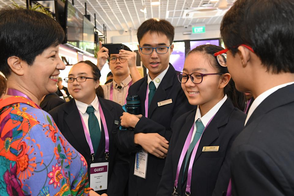 Second Minister for Education Indranee Rajah interacting with Pathlight students at the launch of the Professor Brawn Cafe at its Ang Mo Kio permanent campus on 26 July, 2019. (PHOTO: Pathlight)