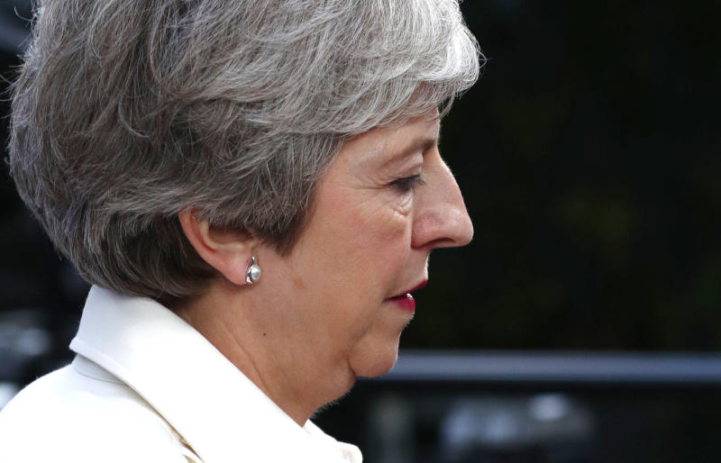 British Prime Minister Theresa May arrives for an EU summit in Brussels, Sunday, June 30, 2019. European Union leaders have started another marathon session of talks desperately seeking a breakthrough in a diplomatic fight over who should be picked for a half dozen of jobs at the top of EU institutions. (Francois Lenoir, Pool Photo via AP)