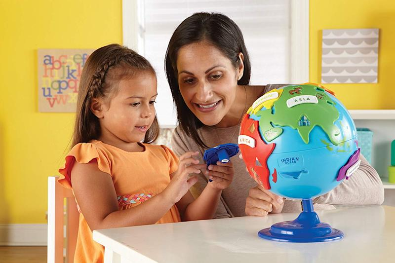 Tiny tots will love playing with the spinning globe. (Photo: Amazon)