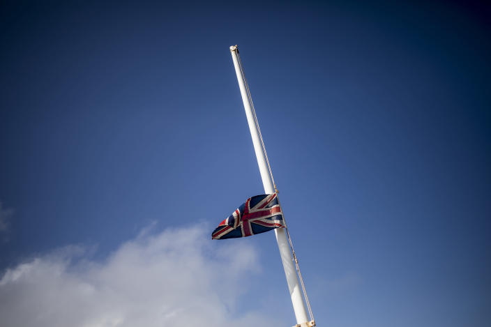 A half-mast Union flag marking the death of Prince Philip, in Gibraltar, Saturday April 10, 2021. Britain's Prince Philip, the irascible and tough-minded husband of Queen Elizabeth II who spent more than seven decades supporting his wife in a role that mostly defined his life, died on Friday. (AP Photo/Javier Fergo)