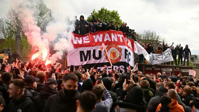 Manchester United's clash with Liverpool was called off on security grounds after fans stormed the Old Trafford pitch in protest against United's owners, the Glazer family