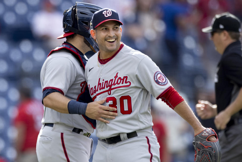 Washington Nationals closing pitcher Paolo Espino, right, celebrates with catcher Alex Avila, left, after the Nationals defeated the Philadelphia Phillies in a baseball game, Wednesday, June 23, 2021, in Philadelphia. (AP Photo/Laurence Kesterson)