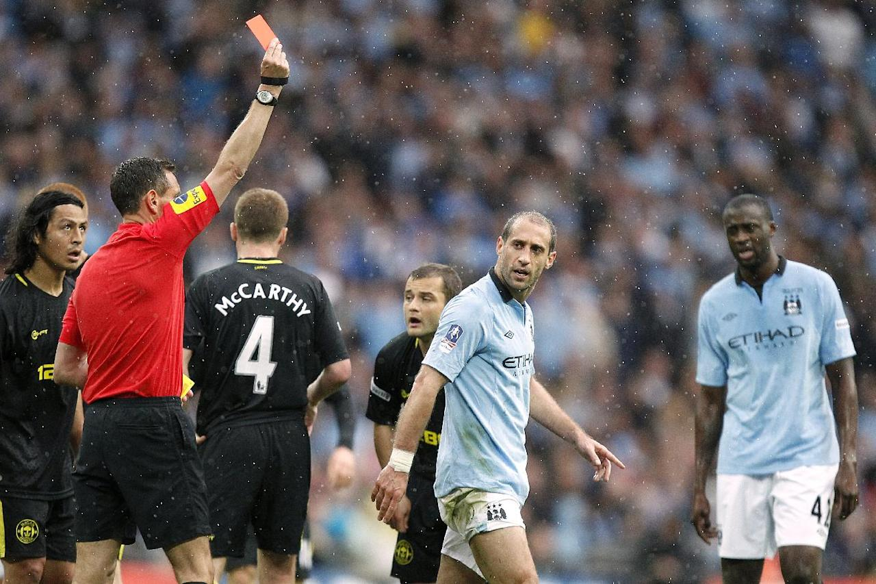 Manchester City's Pablo Zabaleta (right) is sent off by referee Andre Marriner, for a second bookeable offence, following a challenge on Wigan Athletic's Callum McManaman