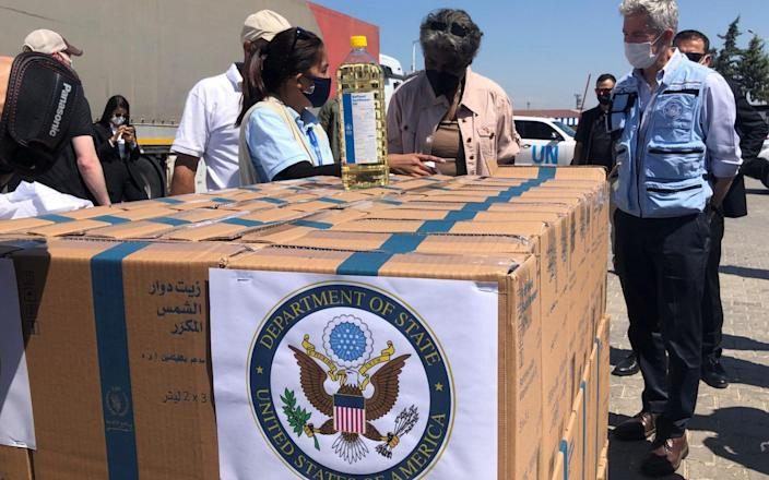 US aid being inspected at the Syrian crossing point of Bab al-Hawa - TUVAN GUMRUKCU/REUTERS
