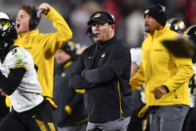 Missouri coach Barry Odom coaches of an NCAA college football game against Georgia, Saturday, Nov. 9, 2019, in Athens, Ga. (AP Photo/John Amis)