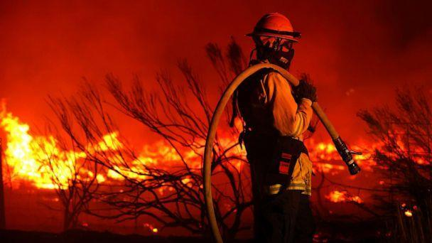 PHOTO: A firefighter monitors the Dixie Fire as it burns close to a home on Aug. 16, 2021, near Janesville, Calif. (Justin Sullivan/Getty Images, FILE)