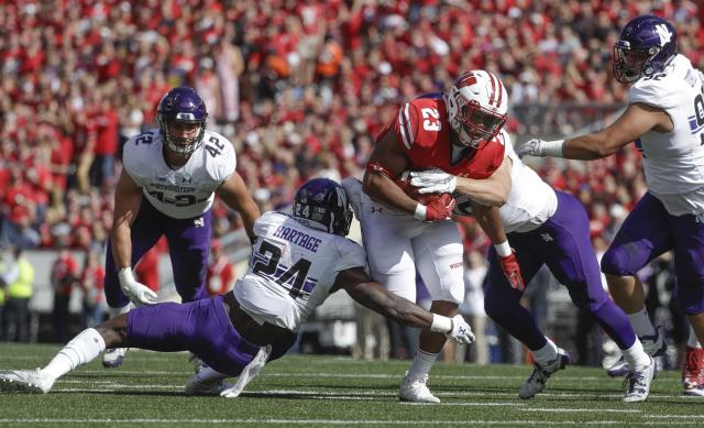 Get used to seeing Wisconsin running back Jonathan Taylor breaking tackles like he did against Northwestern. (AP Photo)