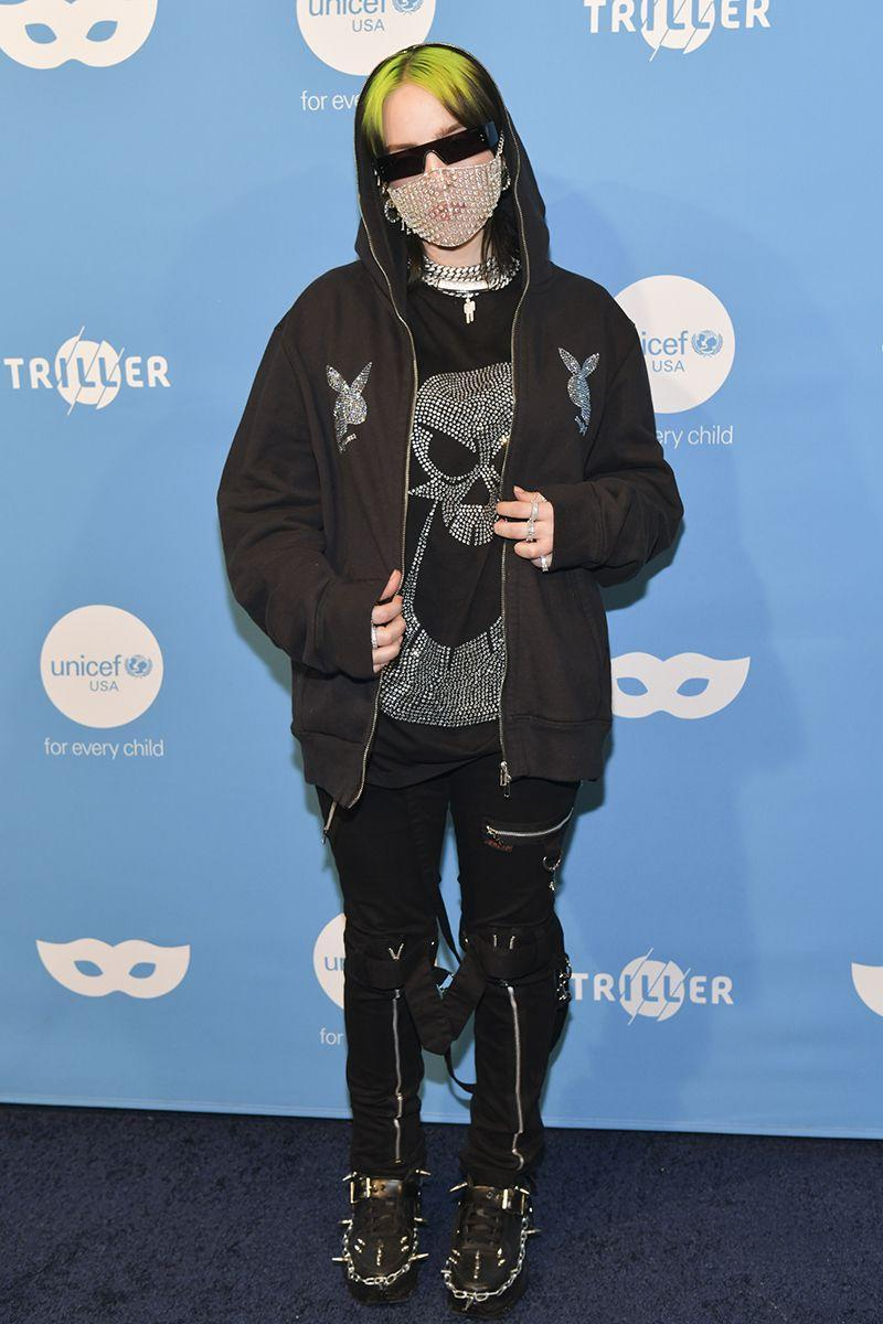 <p>Mixing emo-goth touches with crystal Playboy bunny logos, Billie poses at the UNICEF Masquerade Ball in studded black creepers. </p>