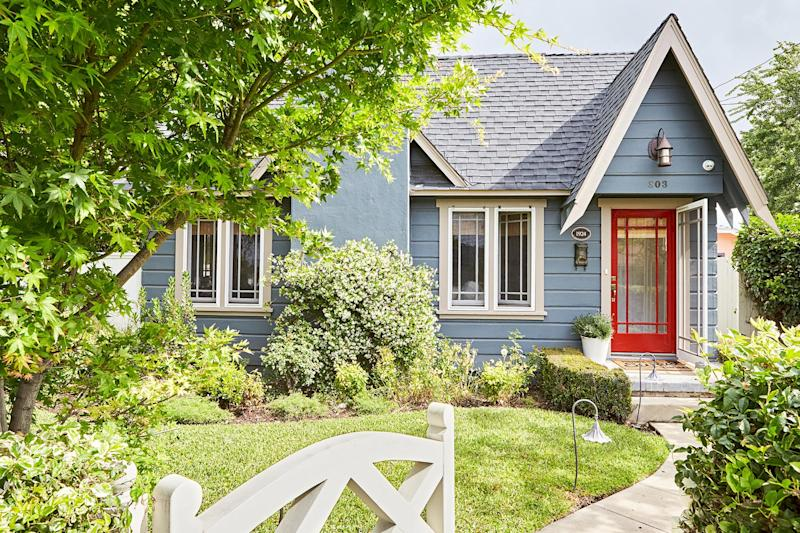 muted blue house with bright red door