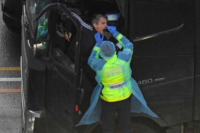 French emergency workers were among those helping to out carry out covid-19 tests on lorry drivers to help traffic get moving