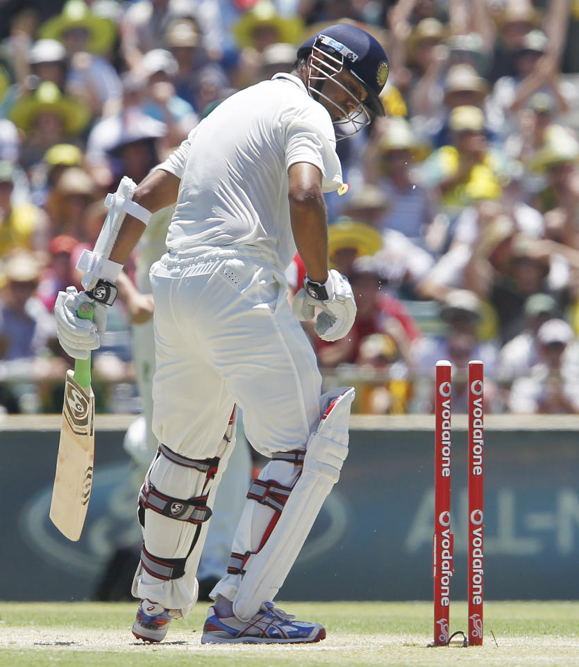 India's Rahul Dravid looks at his stumps after being bowled for 47 runs against Australia on the third day of their cricket test match at the WACA in Perth, Australia, Sunday, Jan. 15, 2012. Australia made 369 in their first innings. (AP Photo/Theron Kirkman)