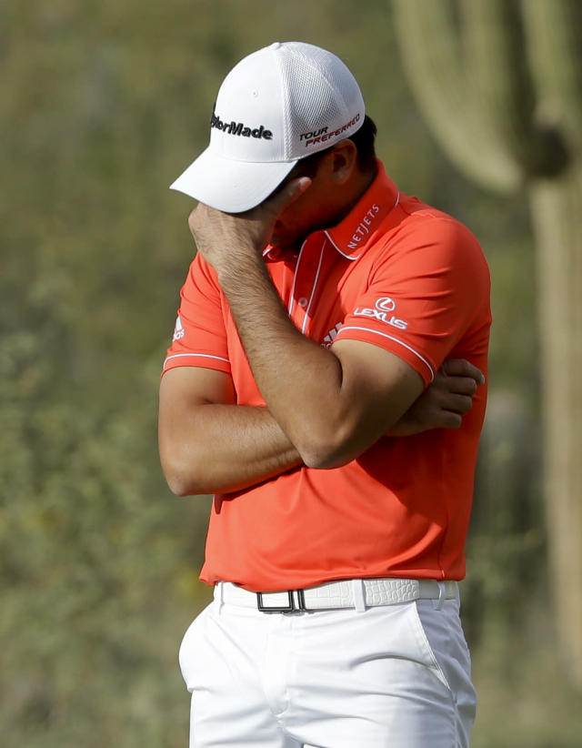Jason Day, of Australia, reacts after missing the winning putt on the 18th hole in his championship match against Victor Dubuisson, of France, during the Match Play Championship golf tournament on Sunday, Feb. 23, 2014, in Marana, Ariz. (AP Photo/Ted S. Warren)