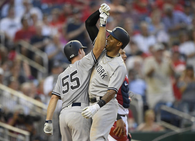 New York Yankees' Aaron Hicks, right, celebrates his two-run home run with Sonny Gray (55) during the fifth inning of a baseball game against the Washington Nationals, Monday, June 18, 2018, in Washington. (AP Photo/Nick Wass)