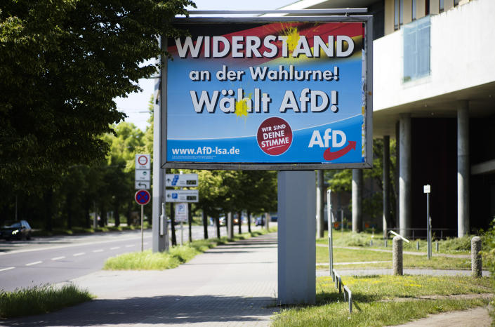An election campaign poster of the far-right Alternative for Germany, AfD, party stands near a road in the federal state Saxony-Anhalt's capital in Magdeburg, Germany, Wednesday, June 2, 2021. The state vote on Sunday, June 6, 2021 is German politicians' last major test at the ballot box before the national election in September that will determine who succeeds Chancellor Angela Merkel. The poster reads: 'Resistance at the ballot box! Choose AFD'. The poster is violated with dots of yellow color. (AP Photo/Markus Schreiber)