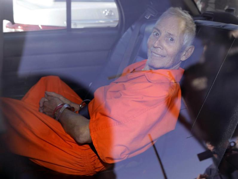 """FILE - In March 17, 2015, file photo, New York real estate heir Robert Durst smiles as he is transported from Orleans Parish Criminal District Court to the Orleans Parish Prison after his arraignment on murder charges in New Orleans. Durst's close friend Nathan Chavin said Friday, Feb. 17, 2017, that it took seven months for him to come clean and tell prosecutors what the real estate heir said about killing their close friend. Chavin said he struggled during that time to balance his loyalties to two best friends before deciding to tell """"the whole truth"""" about what he knew about Susan Berman's death. (AP Photo/Gerald Herbert, File)"""