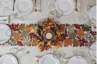 """<p>For an easy centerpiece that doesn't interfere with sightlines across the table, look to an <a href=""""https://www.townandcountrymag.com/style/home-decor/g28565678/halloween-wreaths/"""" rel=""""nofollow noopener"""" target=""""_blank"""" data-ylk=""""slk:autumn-themed wreath"""" class=""""link rapid-noclick-resp"""">autumn-themed wreath</a>. Place a serving piece, cakestand, candle, or vase in the hole at the center and you have an instant tablescape. </p><p><a class=""""link rapid-noclick-resp"""" href=""""https://go.redirectingat.com?id=74968X1596630&url=https%3A%2F%2Ffood52.com%2Fshop%2Fproducts%2F5885-mixed-marigold-wreath&sref=https%3A%2F%2Fwww.townandcountrymag.com%2Fleisure%2Fg13616373%2Fthanksgiving-table-setting-decor-ideas%2F"""" rel=""""nofollow noopener"""" target=""""_blank"""" data-ylk=""""slk:SHOP NOW"""">SHOP NOW</a> <em>Mixed Marigold Wreath, $76</em></p>"""