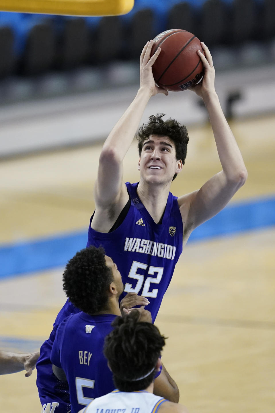 Washington center Riley Sorn (52) takes a shot during the first half of an NCAA college basketball game against the UCLA Saturday, Jan. 16, 2021, in Los Angeles. (AP Photo/Ashley Landis)