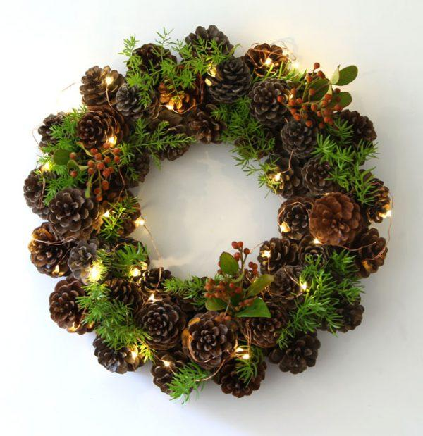 "<p>What better idea than to take a long winter walk collecting pretty pine cones and then making them into a festive wreath.<a rel=""nofollow"" href=""http://www.remodelaholic.com/make-easy-diy-pinecone-wreath-one-hour/""><em> [Photo: Remodelaholic]</em></a> </p>"