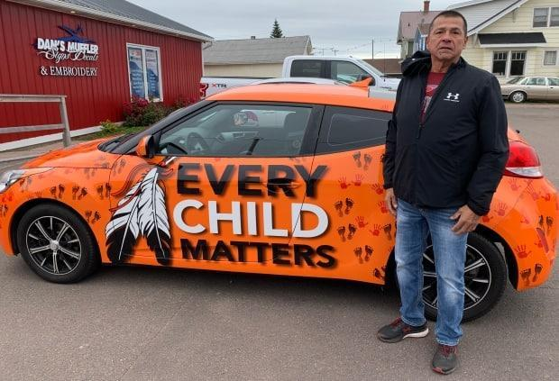 Stephen Bernard didn't want the conversation to stop about residential schools and the possible unmarked graves across the county, so he decided to turn his car into a billboard to raise awareness. (Tony Davis/CBC - image credit)