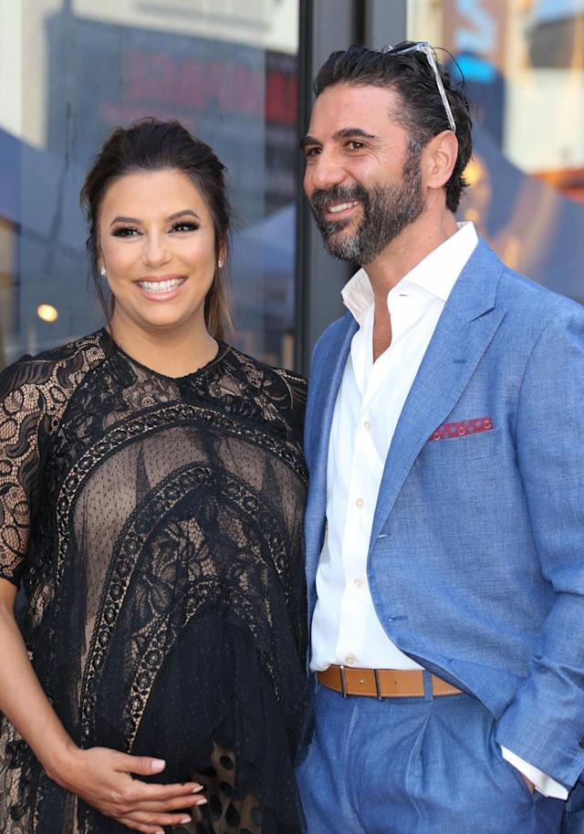 Eva Longoria and husband José Bastón, shown here at her Hollywood Walk of Fame Star ceremony on April 16, have welcomed a son. (Photo: Frederic J. Brown/AFP)