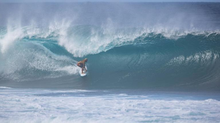 Italo Ferreira catches a wave during the Pipeline Masters 2020 in Hawaii